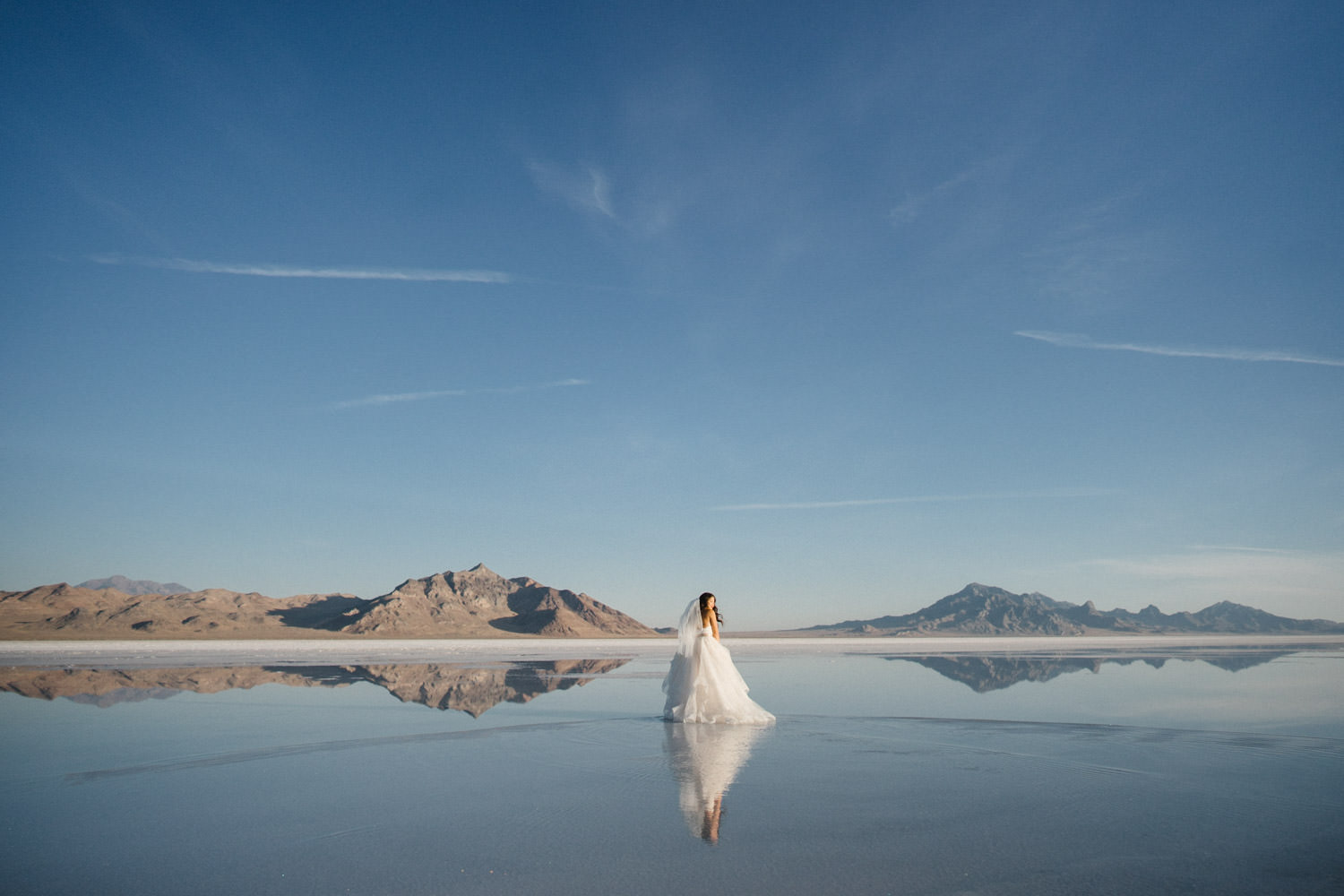 Bonneville Salt Flats wedding bride with landscape and reflection photo