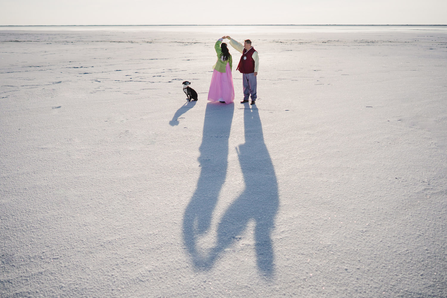 Bonneville Salt Flats wedding bride and groom in Hanbok with dog nearby photo