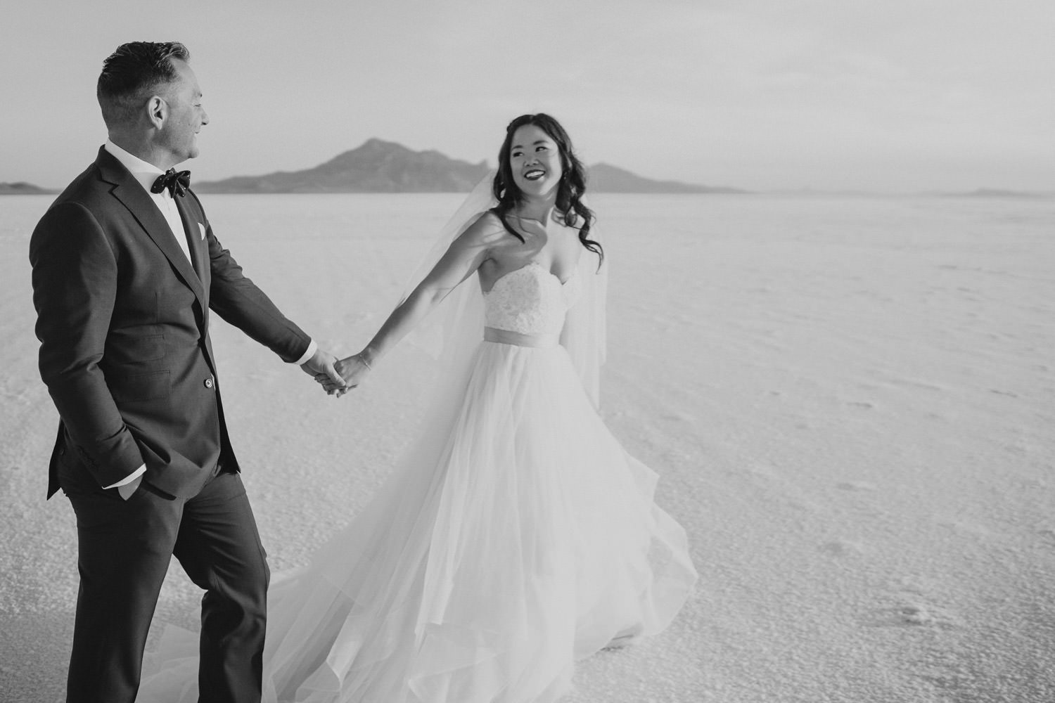 Bonneville Salt Flats wedding black and white couple holding hands photo