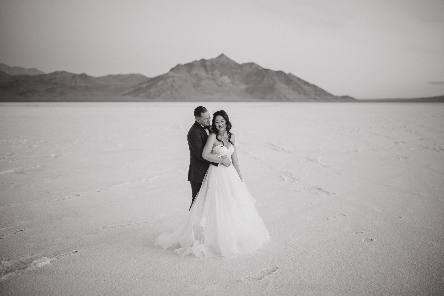 Bonneville Salt Flats wedding black and white couple hugging photo