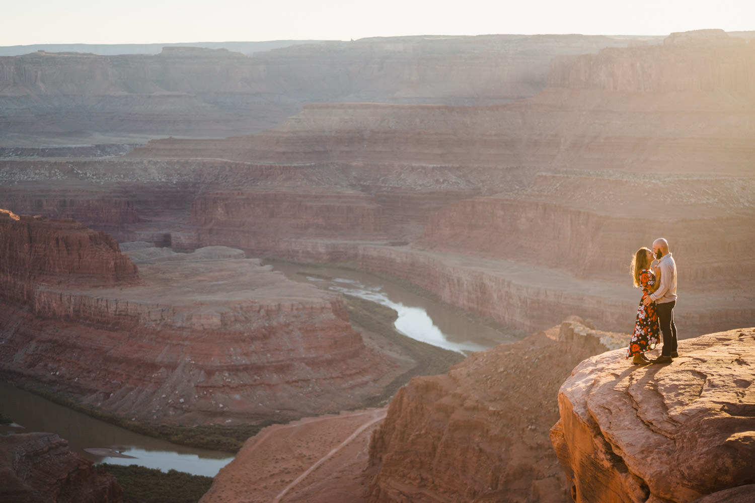 Dead Horse Point engagement intimate look with Colorado River backdrop photo