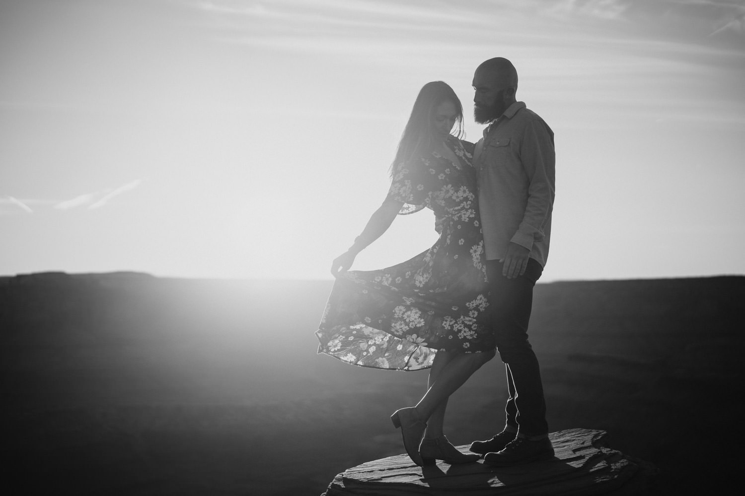 Dead Horse Point engagement black and white couple on rock photo