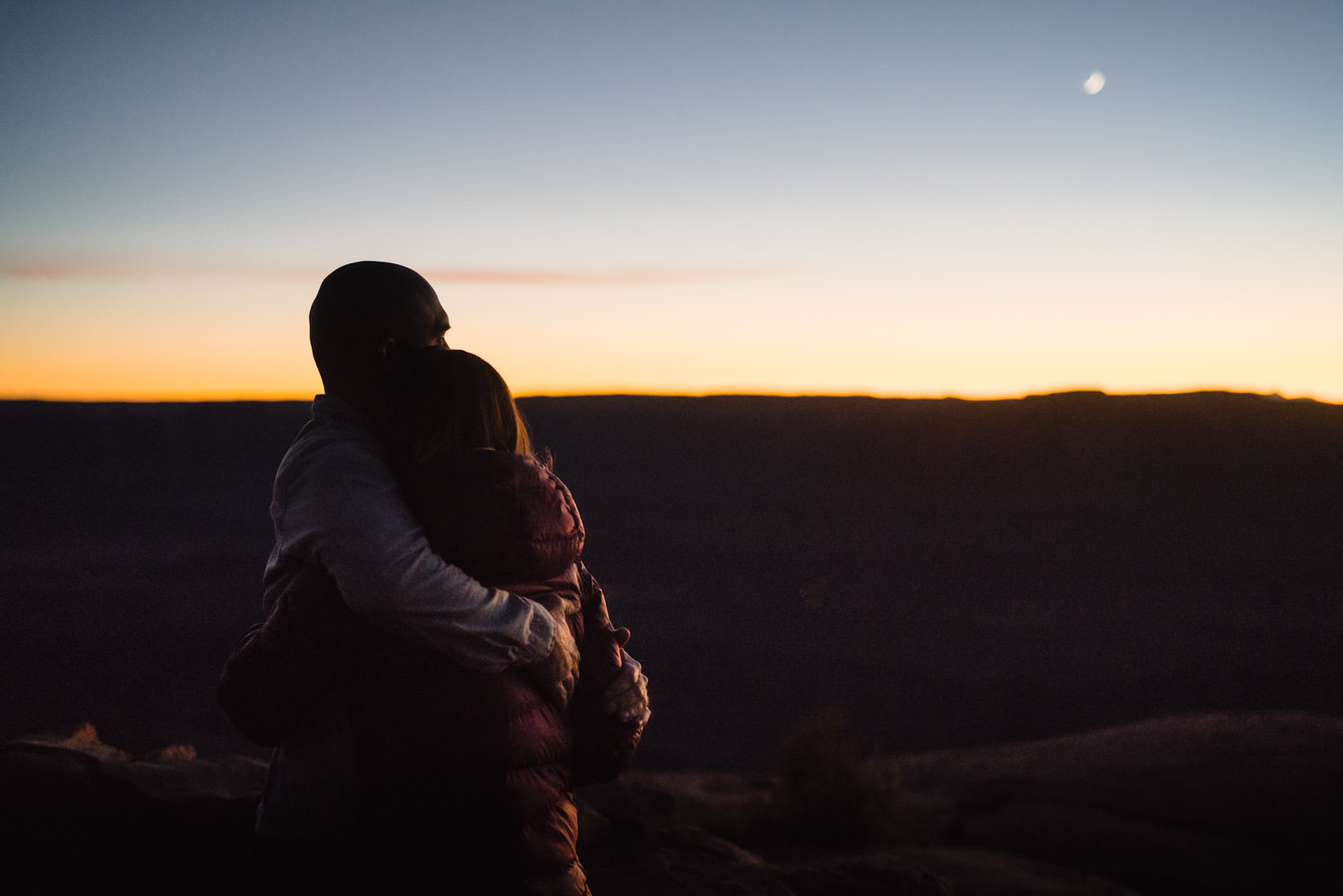 Dead Horse Point engagement couple hugging during sunset photo