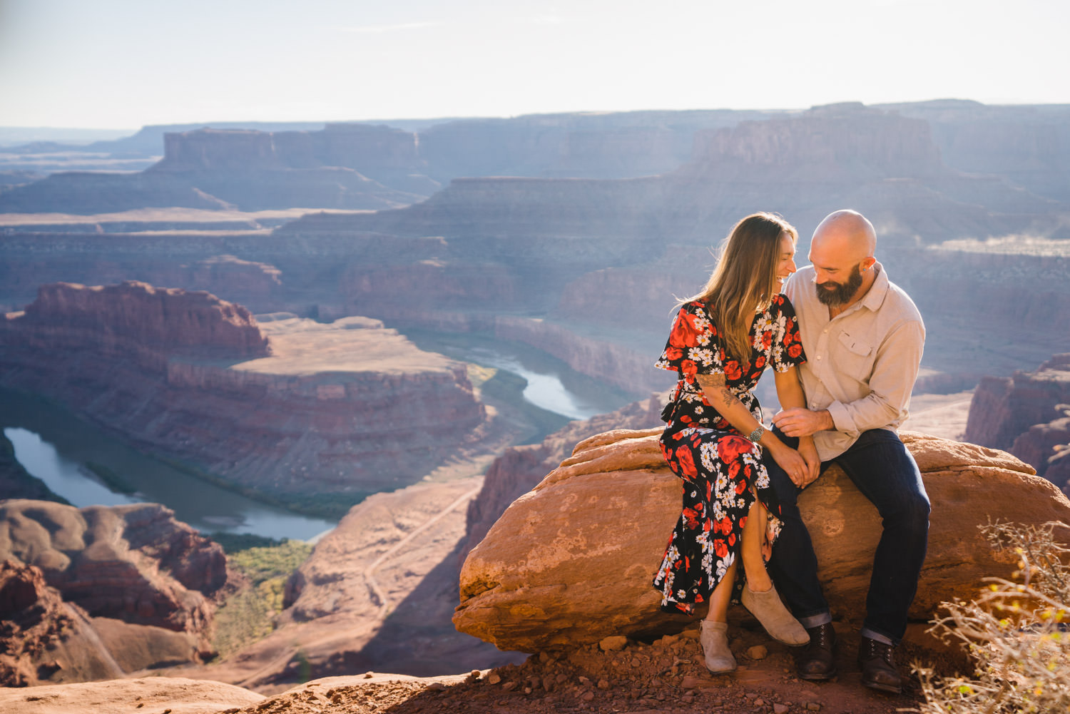 Dead Horse Point engagement couple with Colorado River overlook background photo