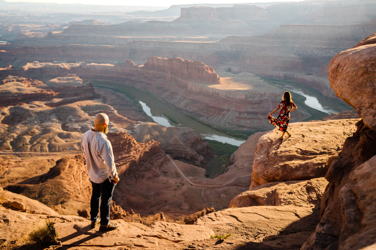 Dead Horse Point engagement couple looking over Colorado River photo