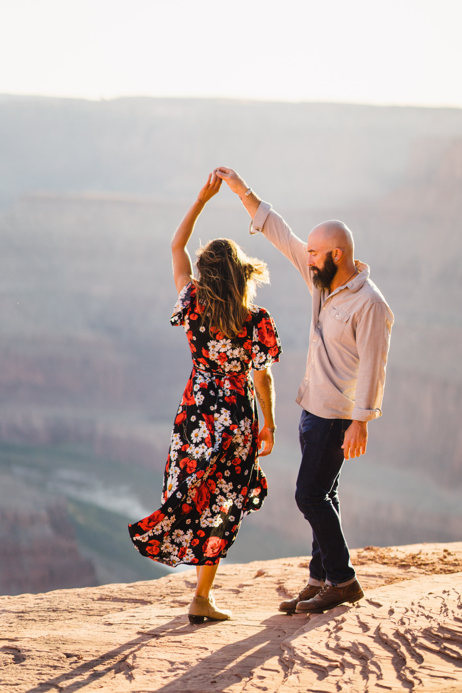 Dead Horse Point engagement couple dancing and twirling photo