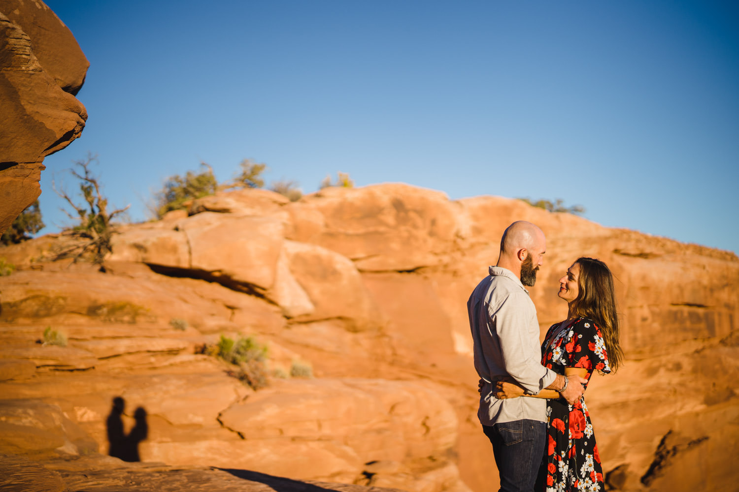 Dead Horse Point engagement hugging shadow on red rocks photo