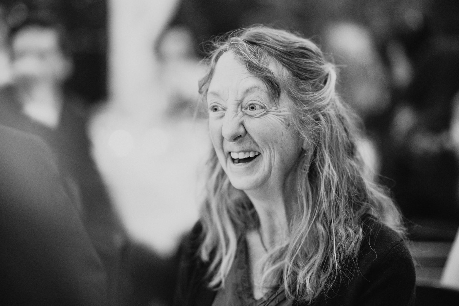 Millcreek Inn wedding black and white guest laughing photo