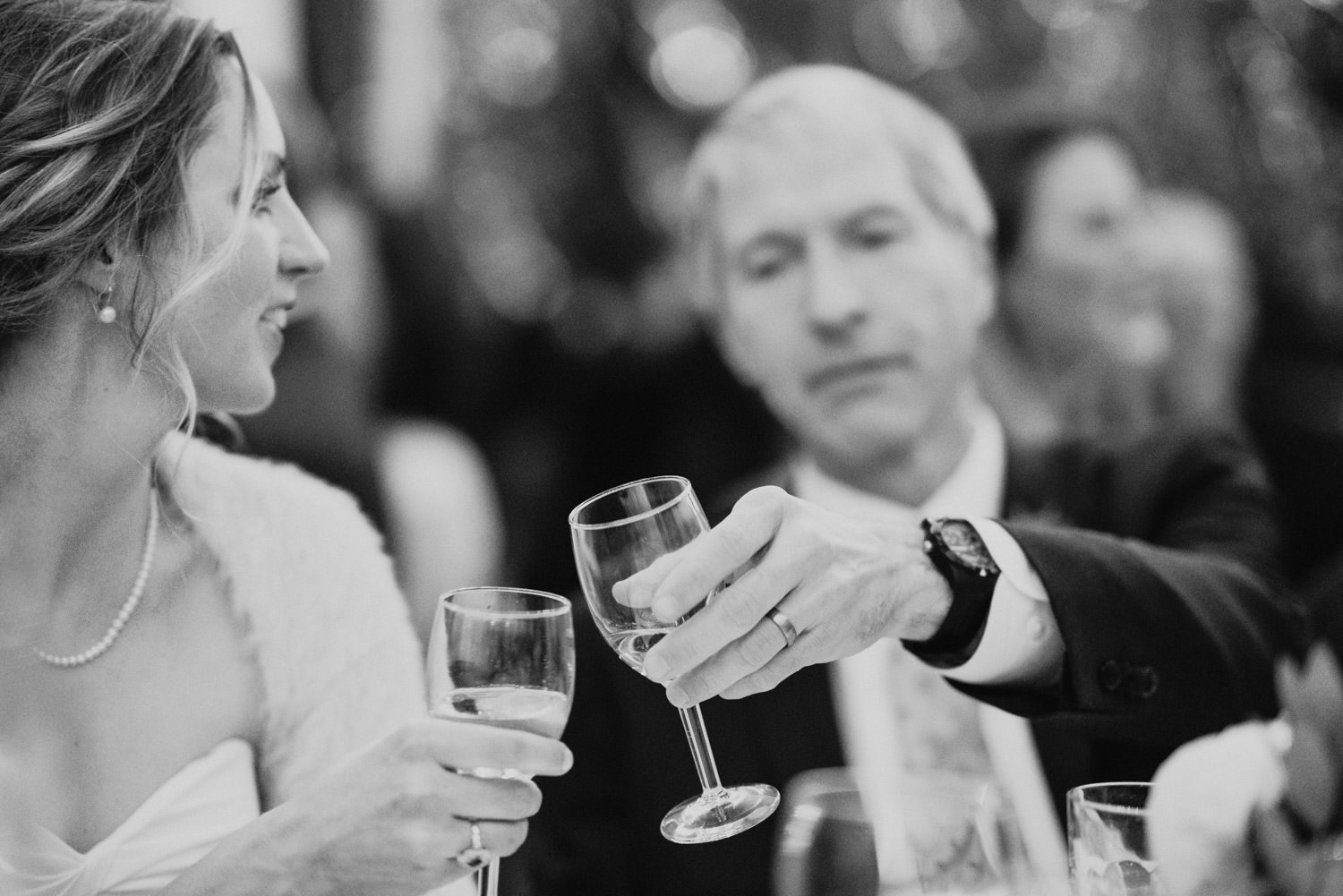 Millcreek Inn wedding black and white bride and groom toasting photo