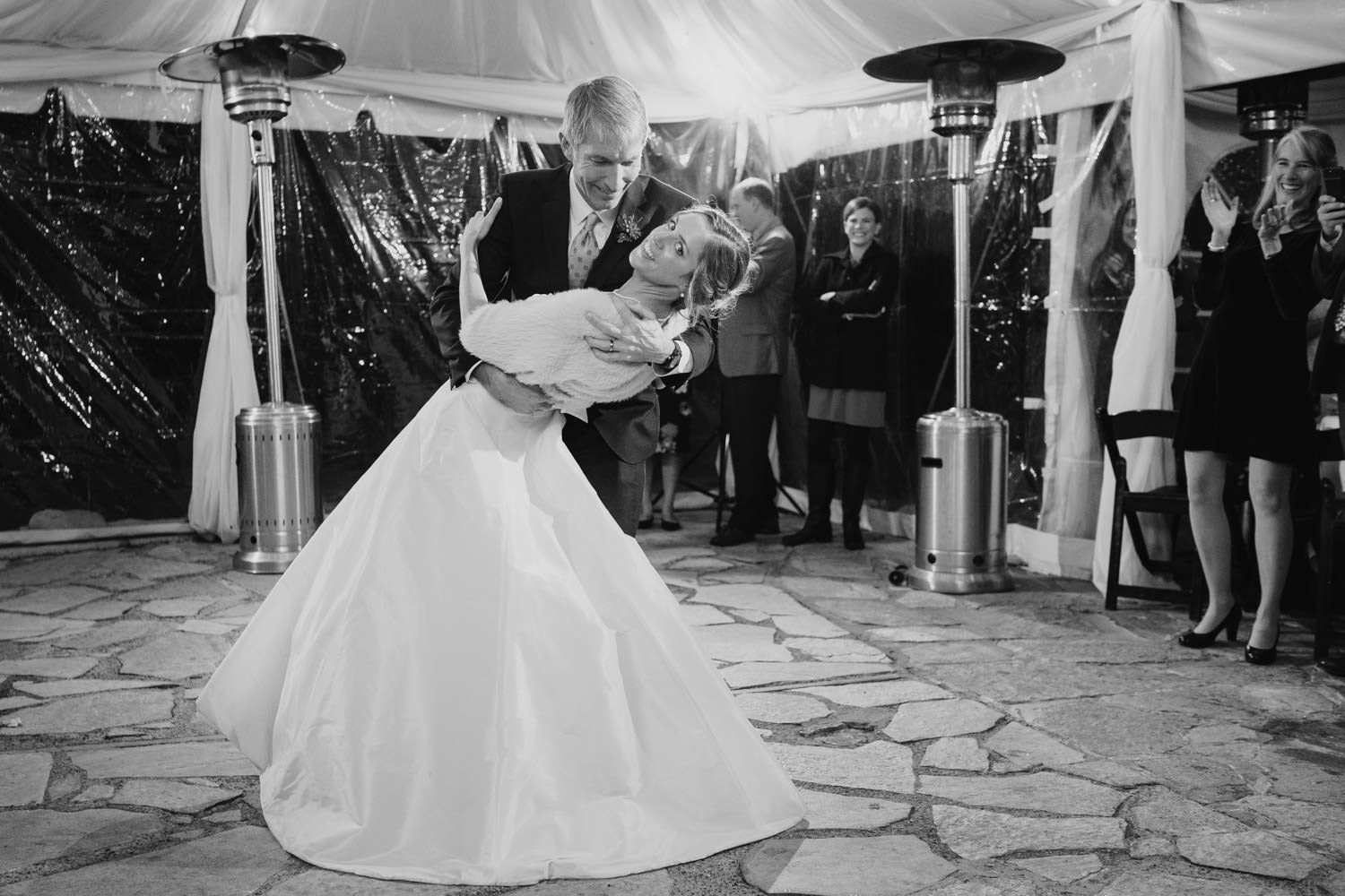 Millcreek Inn wedding black and white bride dips while dancing photo