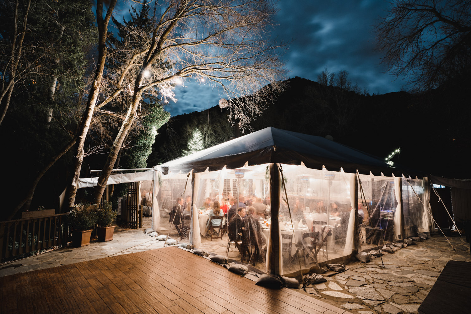Millcreek Inn wedding lit-up tent under night sky photo