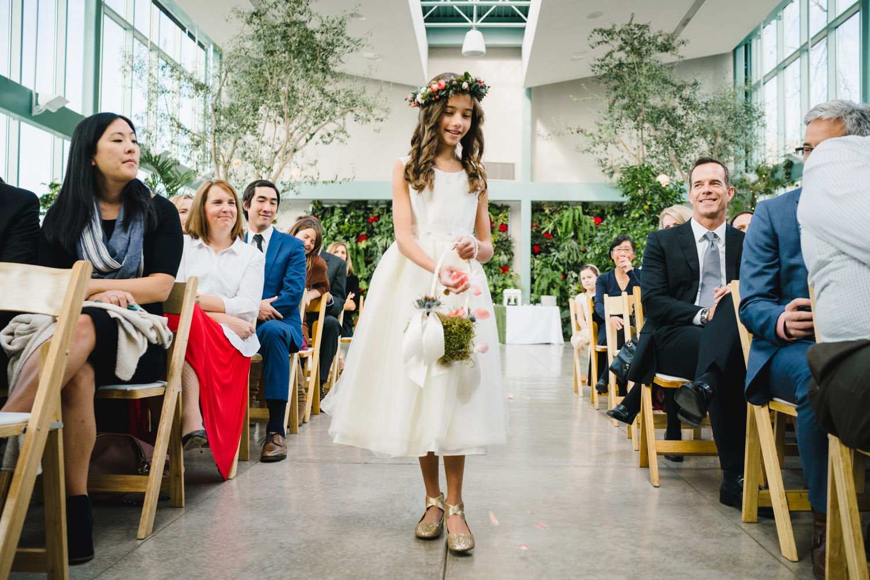 Red Butte Garden wedding flower girl walking down aisle photo