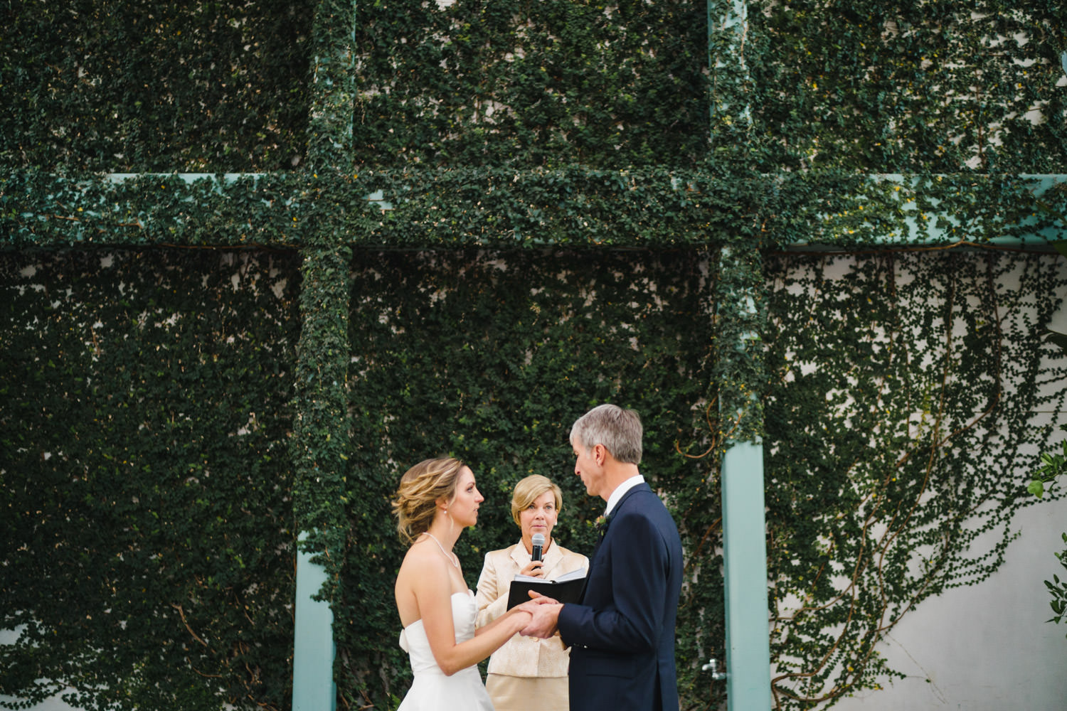 Red Butte Garden wedding bride and groom in front of vine wall photo