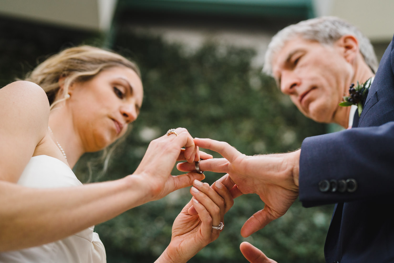 Red Butte Garden wedding bride and groom exchanging rings photo