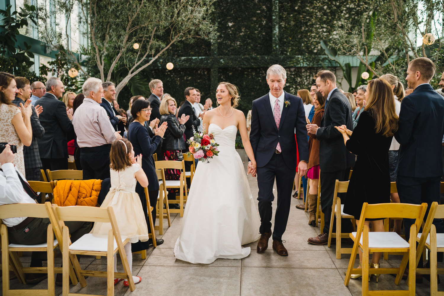 Red Butte Garden wedding bride and groom exiting ceremony down aisle photo