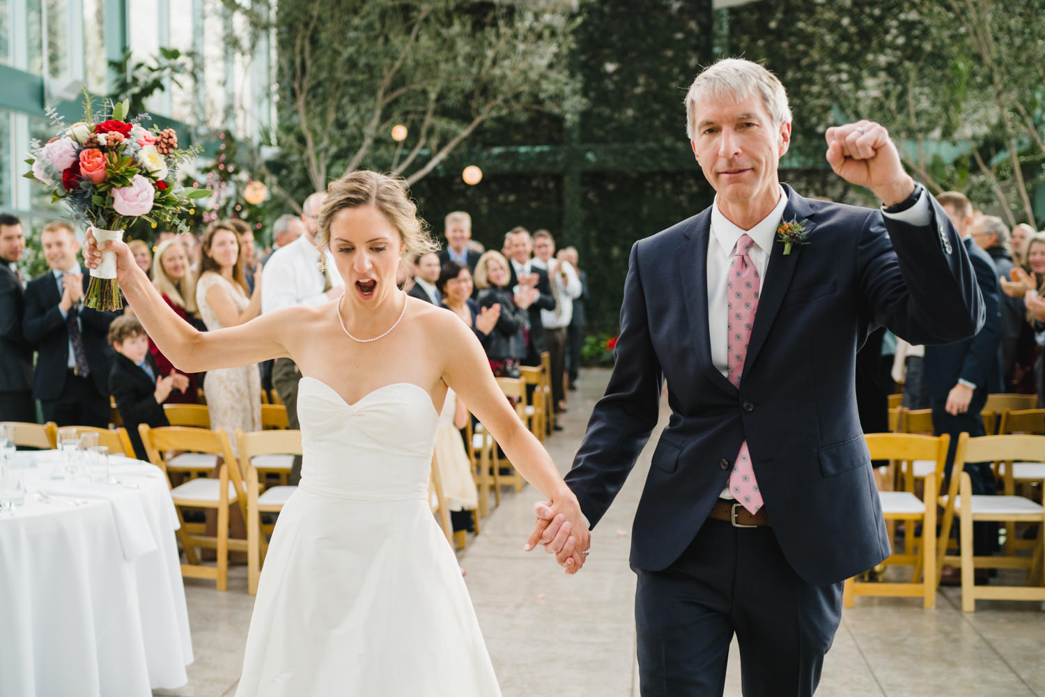 Red Butte Garden wedding bride and groom cheering after ceremony photo