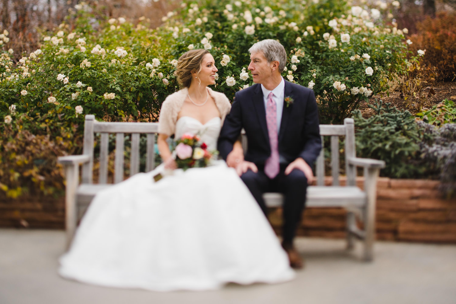 Red Butte Garden wedding bride and groom on bench photo