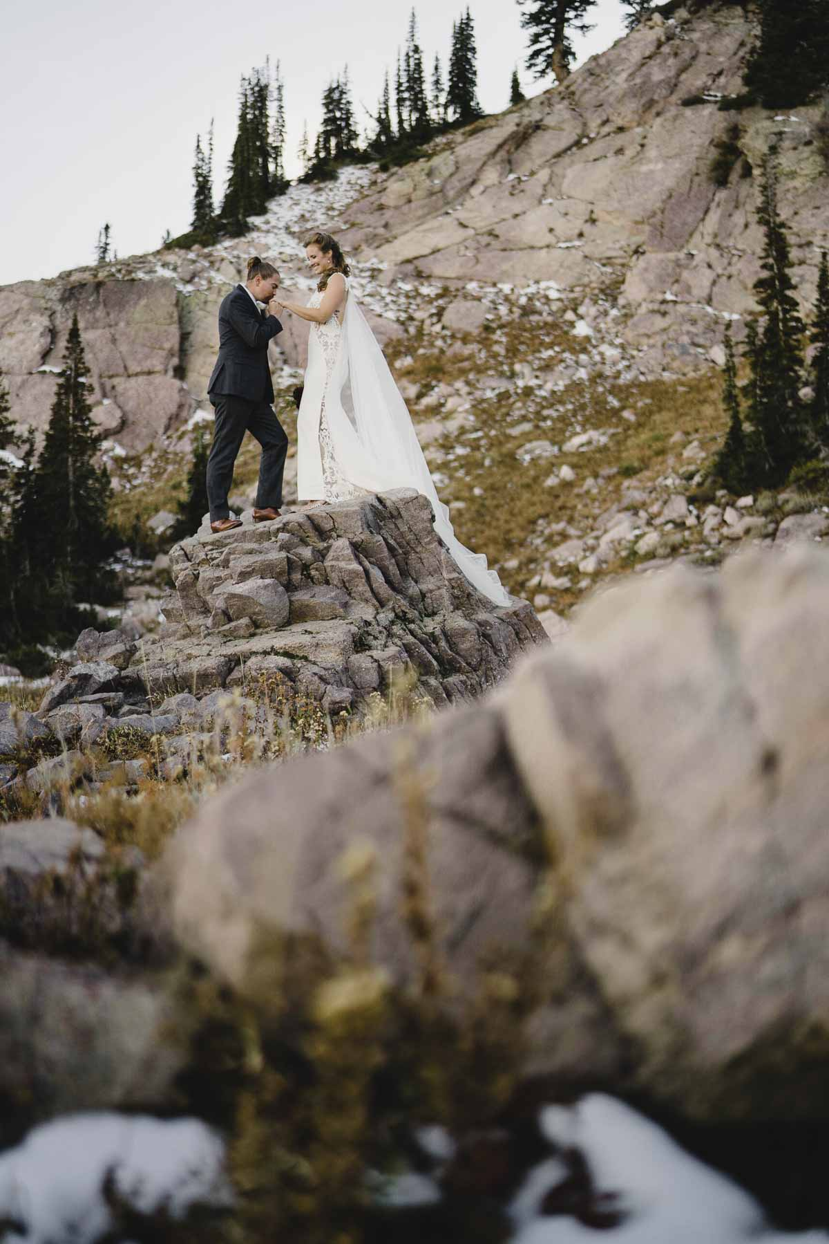 Snowbasin wedding groom kissing bride's hand photo