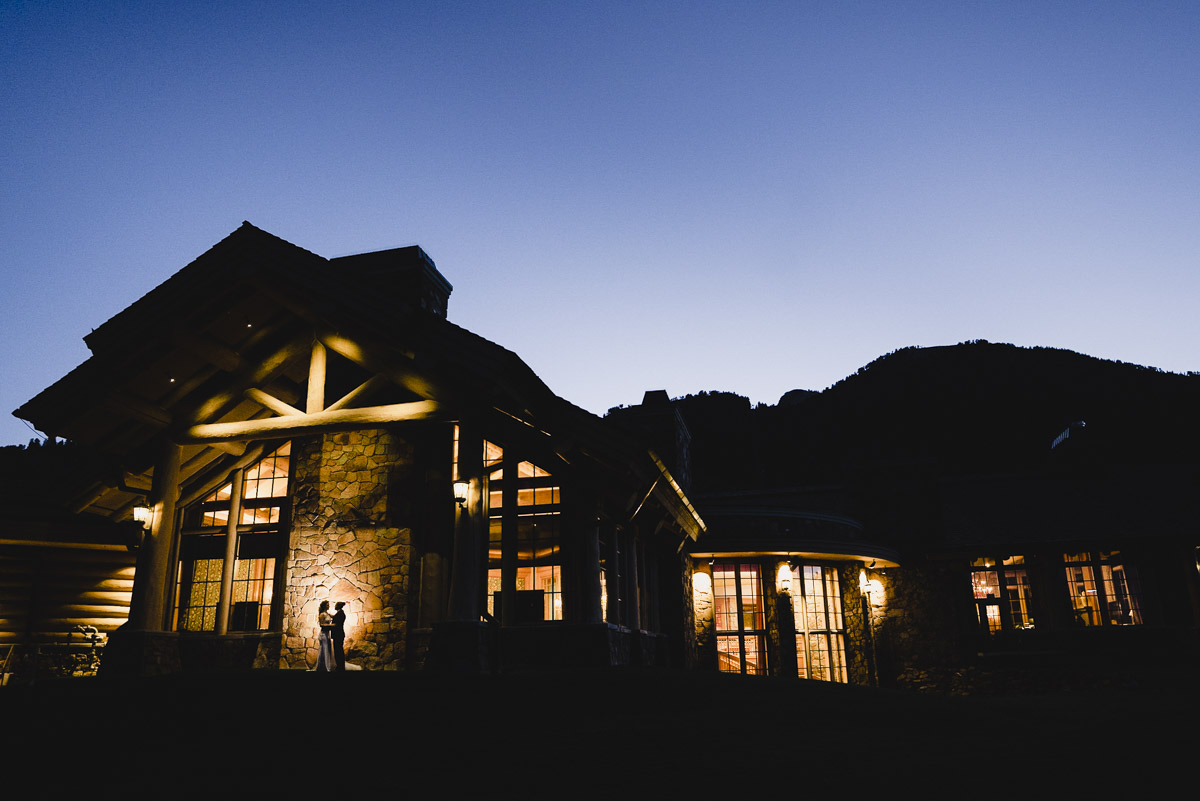 Snowbasin wedding night sky portrait with lit up lodge photo
