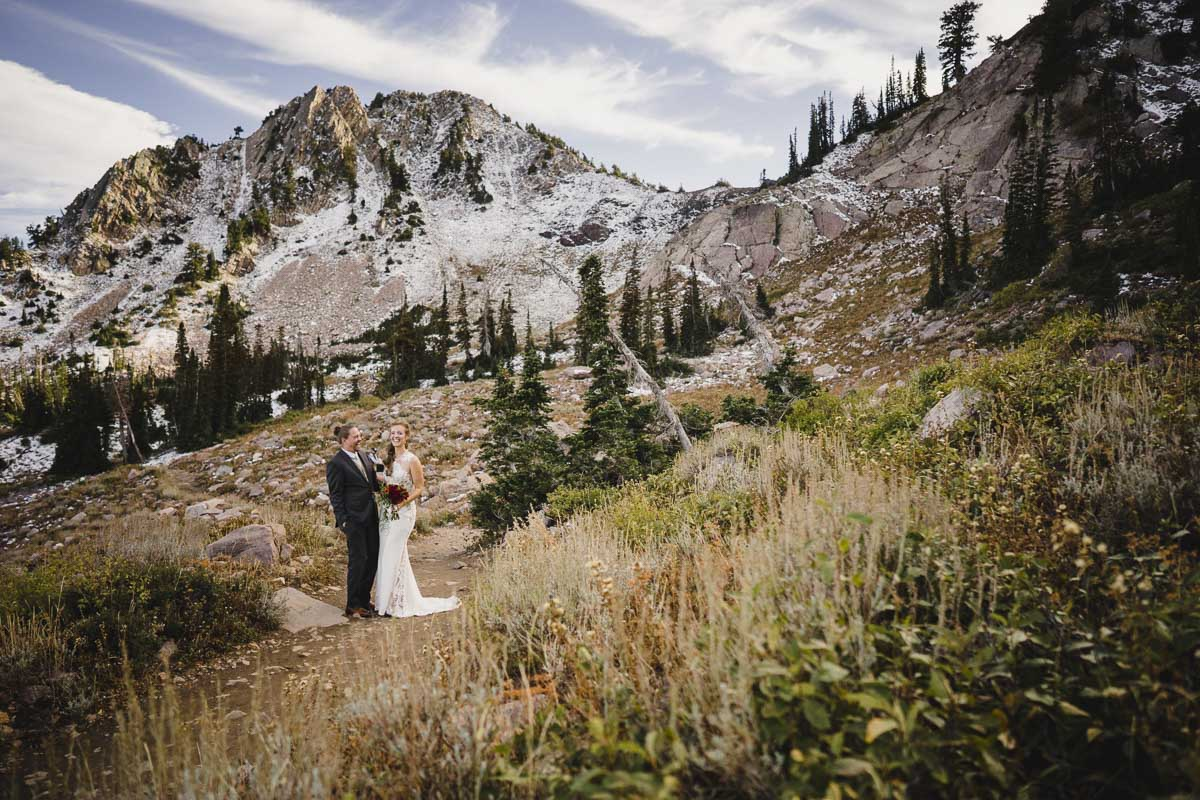 Snowbasin wedding bride and groom with fall landscape photo
