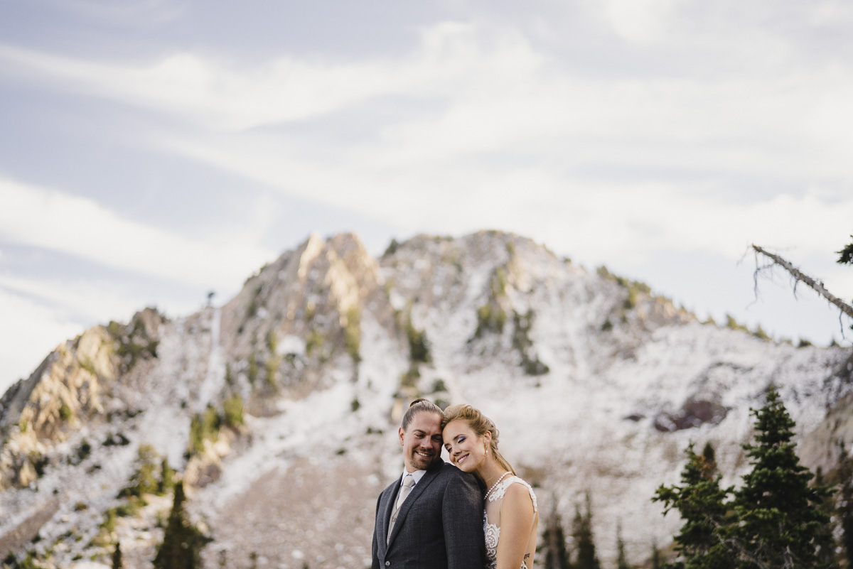 Snowbasin wedding bride and groom hugging and smiling photo