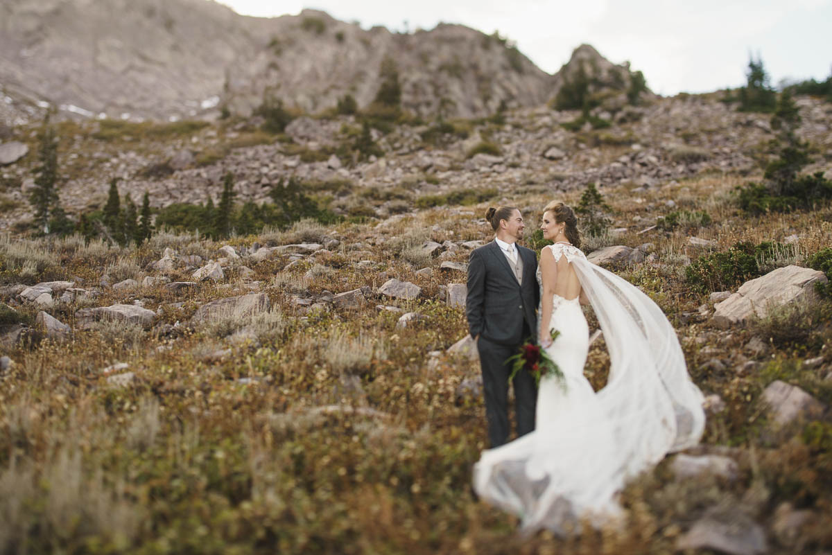 Snowbasin wedding bride and groom with natural rocky landscape photo
