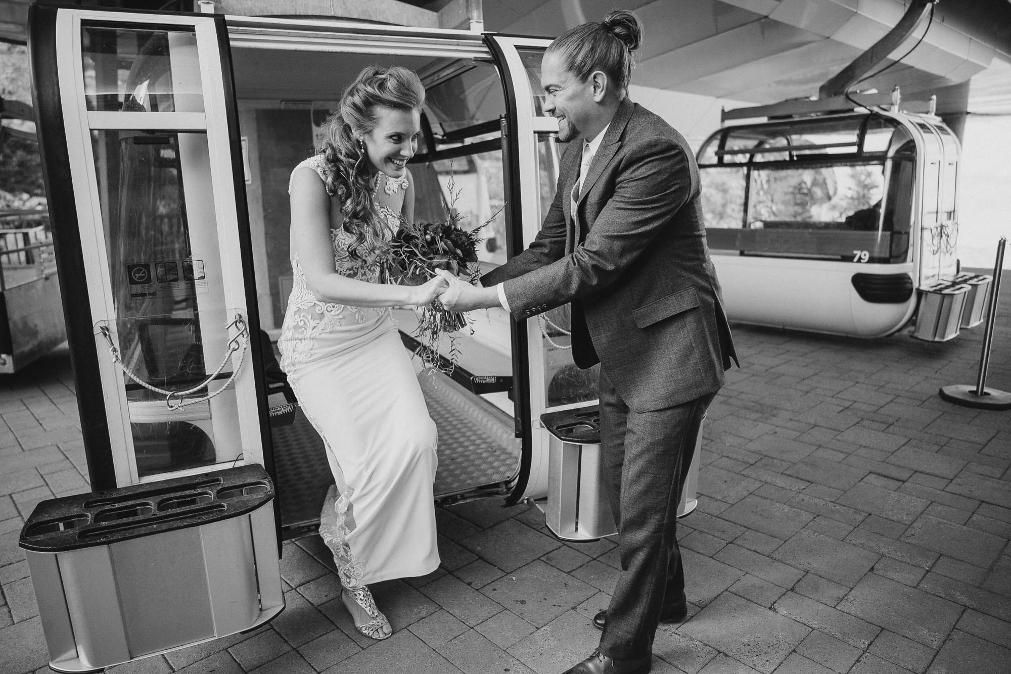 Snowbasin wedding bride and groom exiting gondola photo