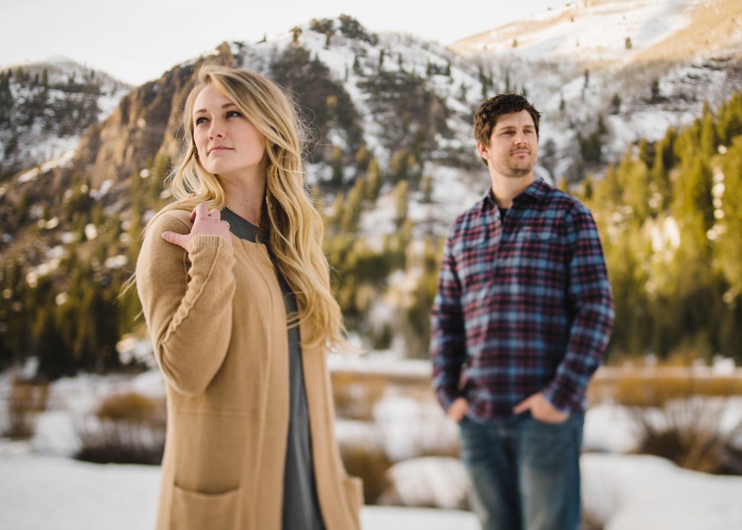 Donut Falls engagement couple looks in opposite directions photo
