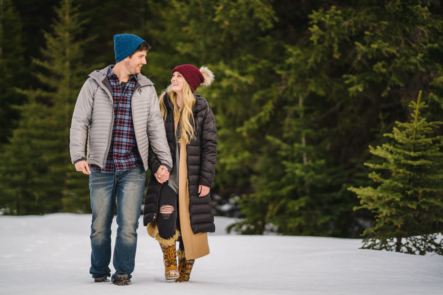 Donut Falls engagement couple walking and smiling in the snow photo