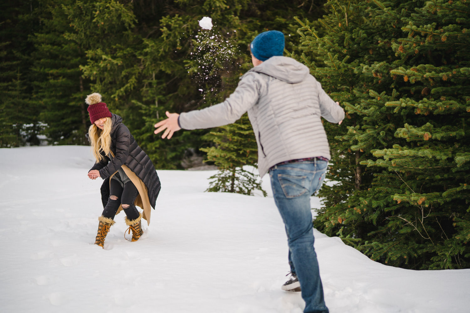 Donut Falls engagement snowball fight photo