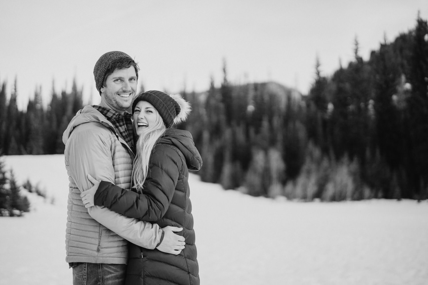 Donut Falls engagement black and white couple hugging photo