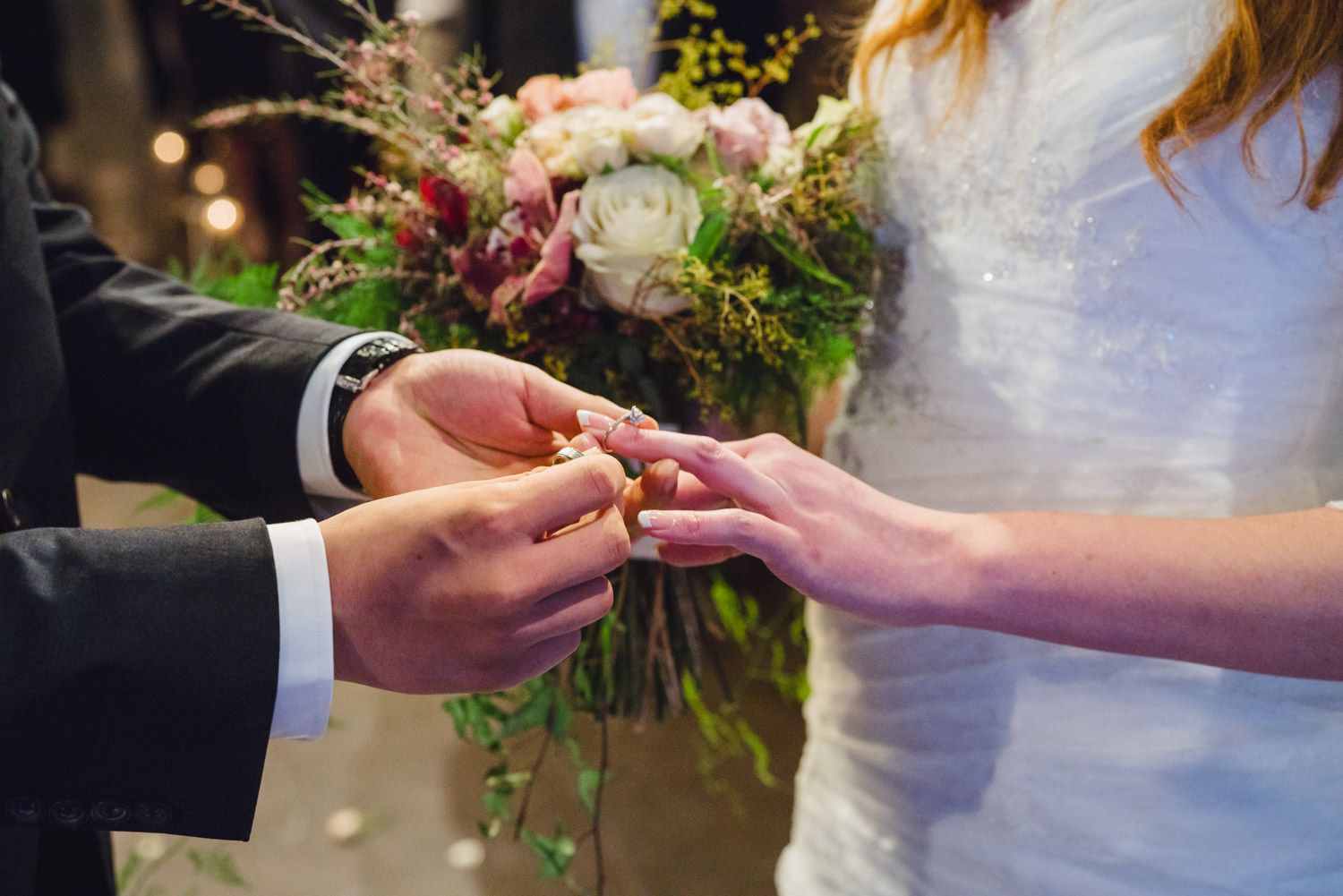 Pierpont Place wedding exchanging rings during ceremony photo