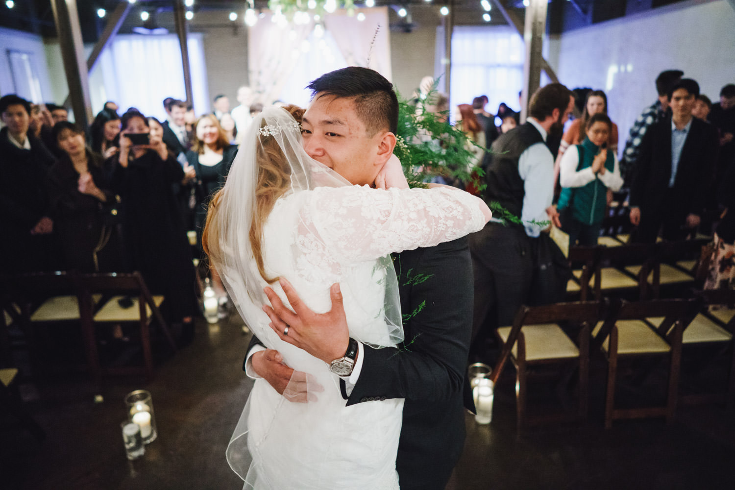 Pierpont Place wedding bride and groom hugging photo