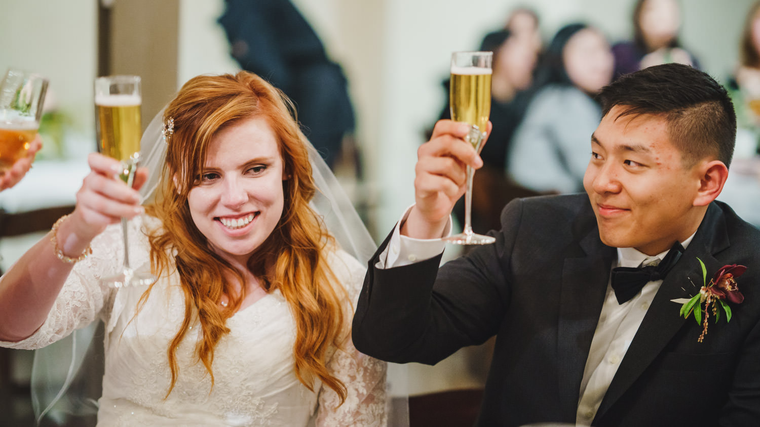 Pierpont Place wedding bride and groom raising champagne glasses photo