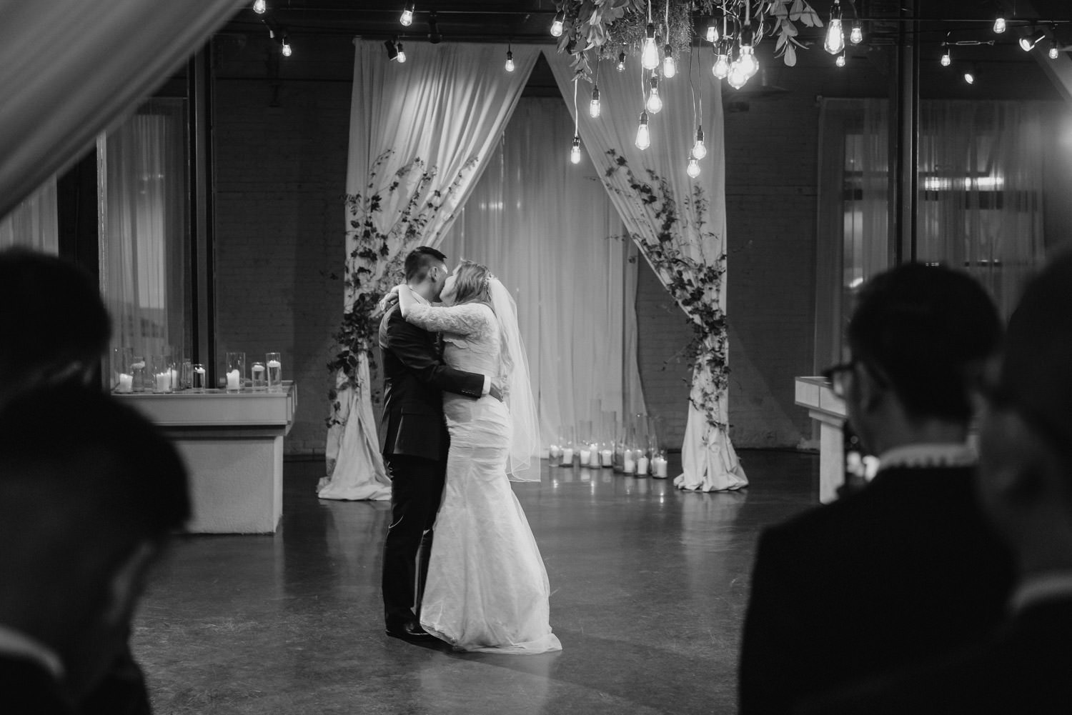 Pierpont Place wedding bride and groom kissing while dancing photo