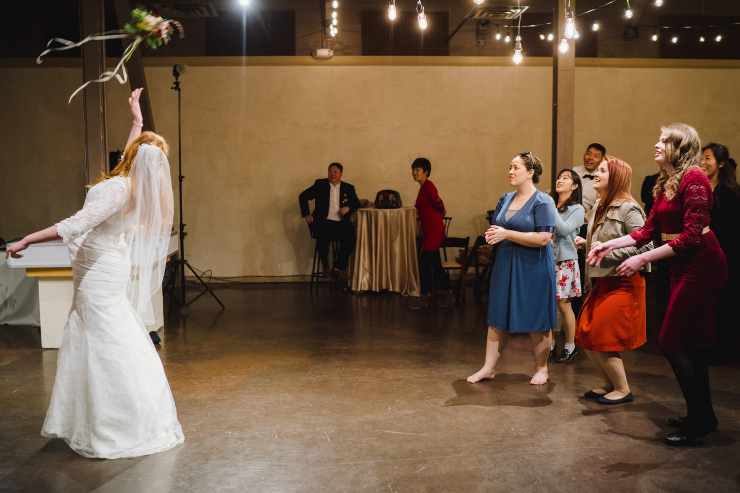 Pierpont Place wedding bride throwing bouquet photo