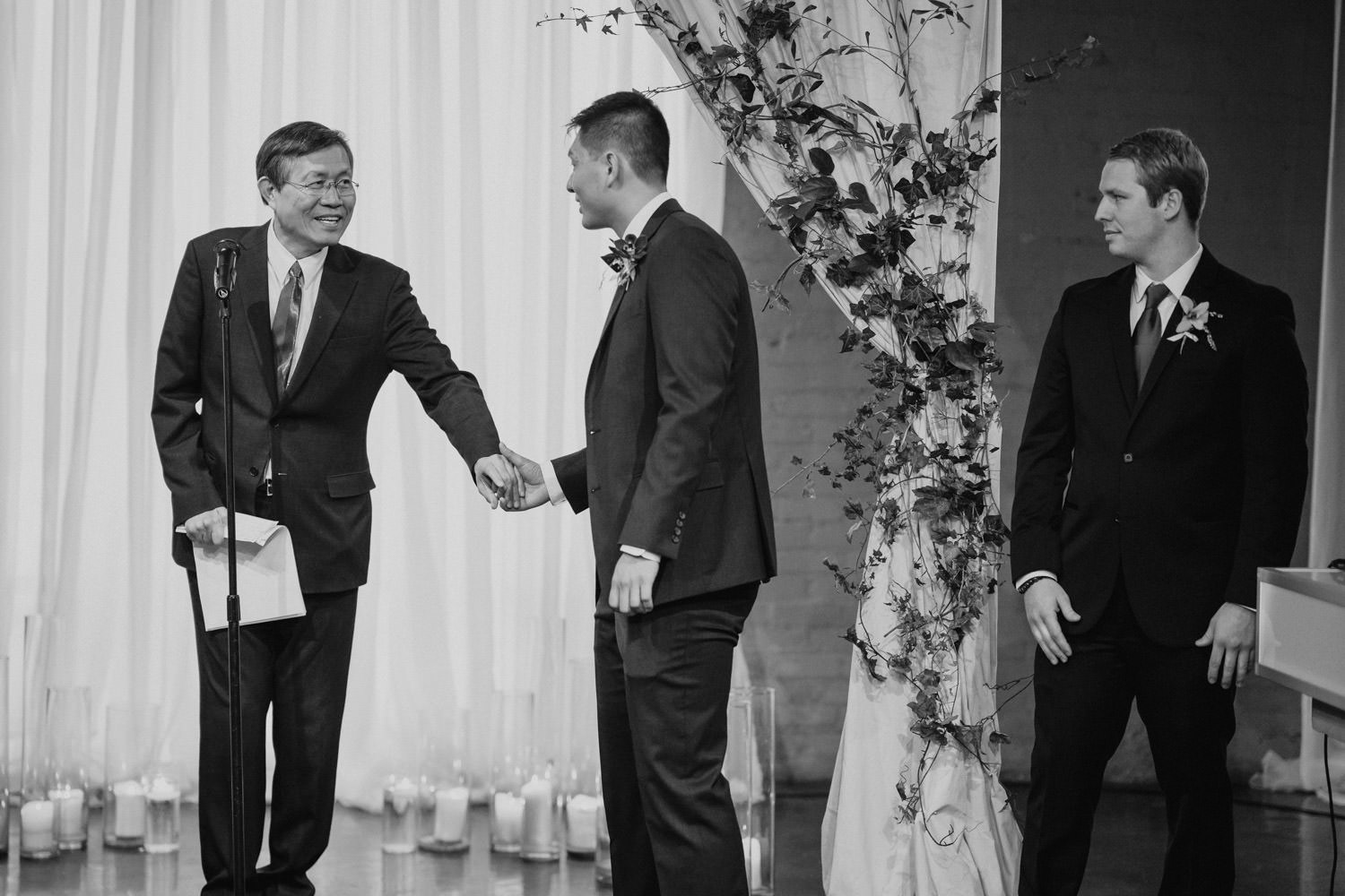 Pierpont Place wedding groom greeting officiant at ceremony photo