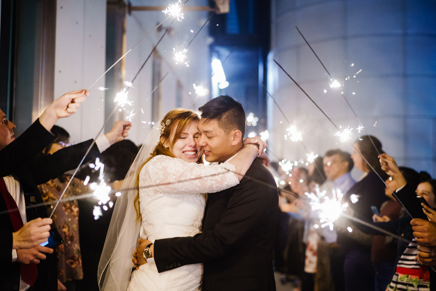 Pierpont Place wedding bride and groom hug with sparklers photo