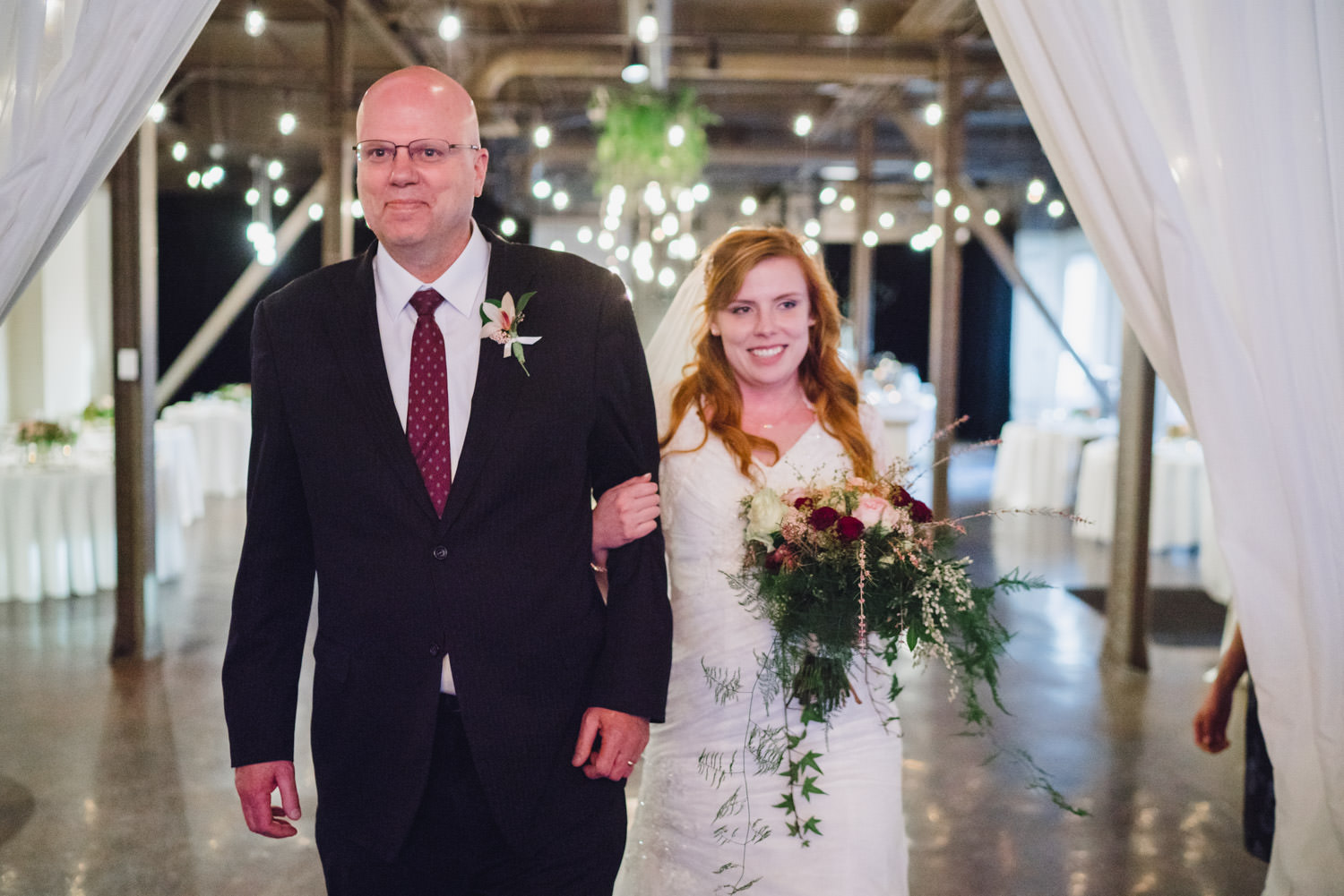 Pierpont Place wedding bride walking down aisle at ceremony photo