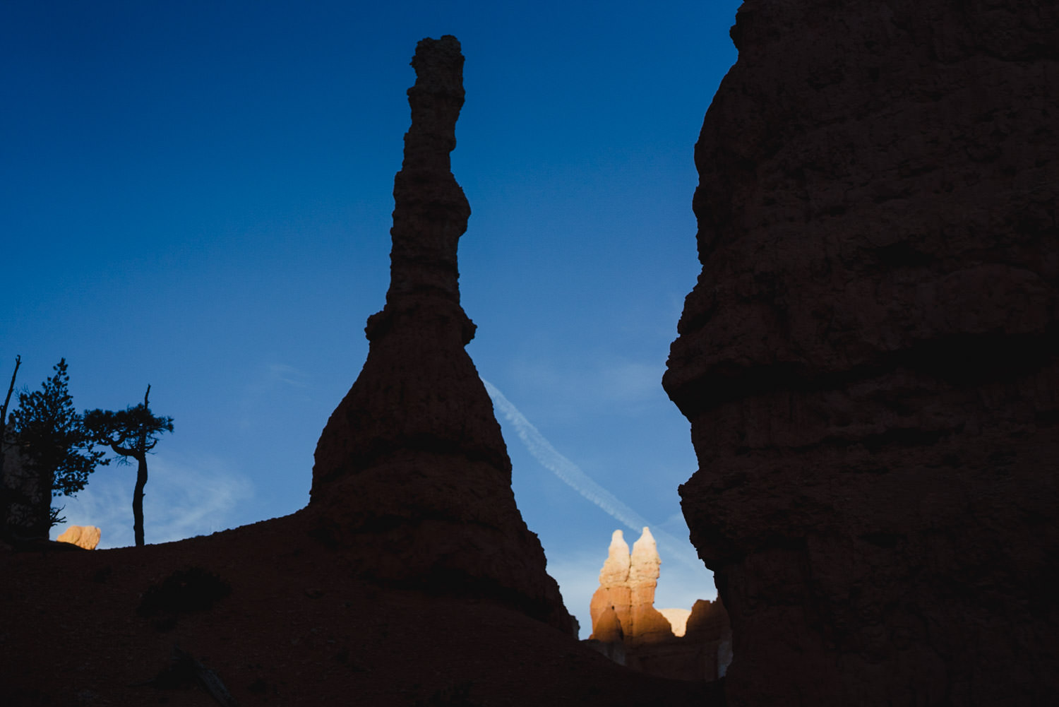 Bryce Canyon elopement rock tower silhouette against blue sky photo