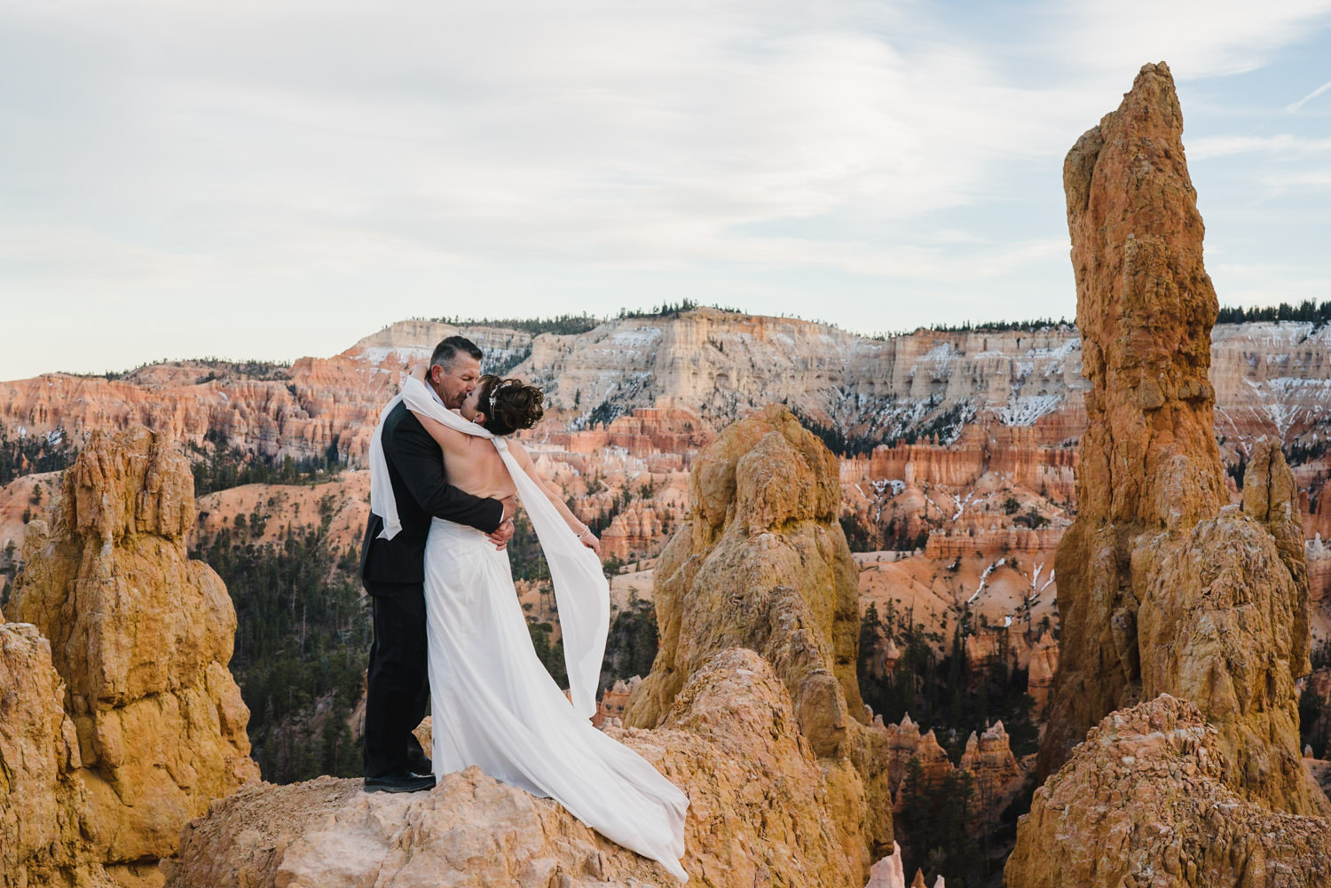 Bryce Canyon elopement bride and groom on rock perch photo