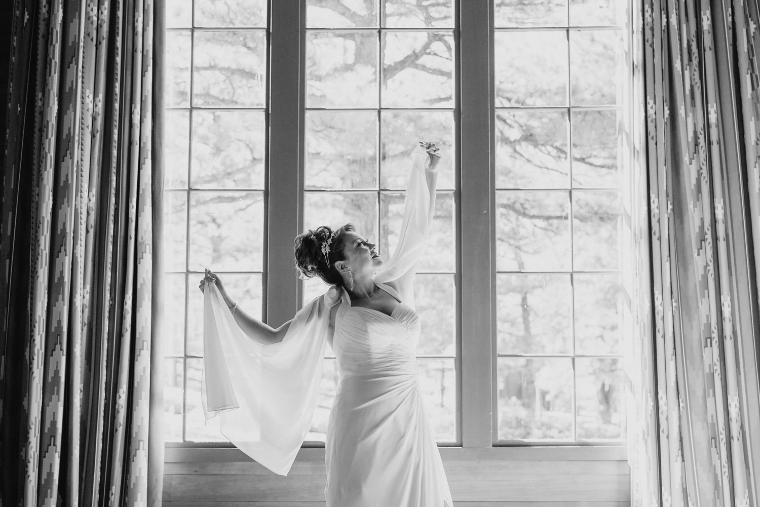 Bryce Canyon elopement black and white bride in front of window photo