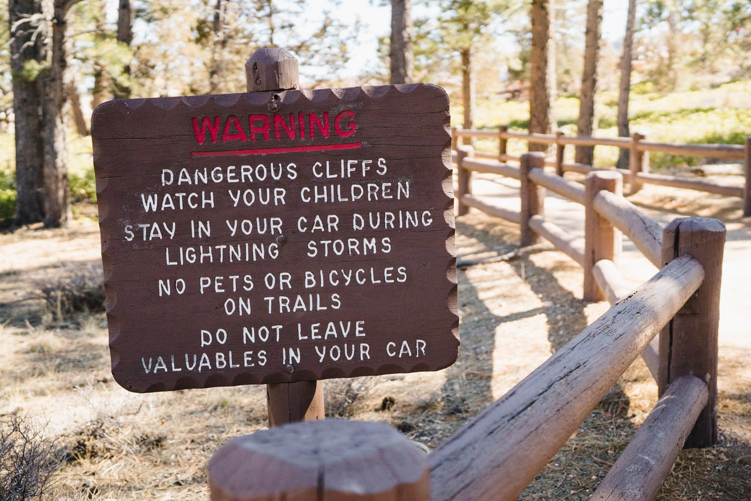 Bryce Canyon elopement warning sign in park photo