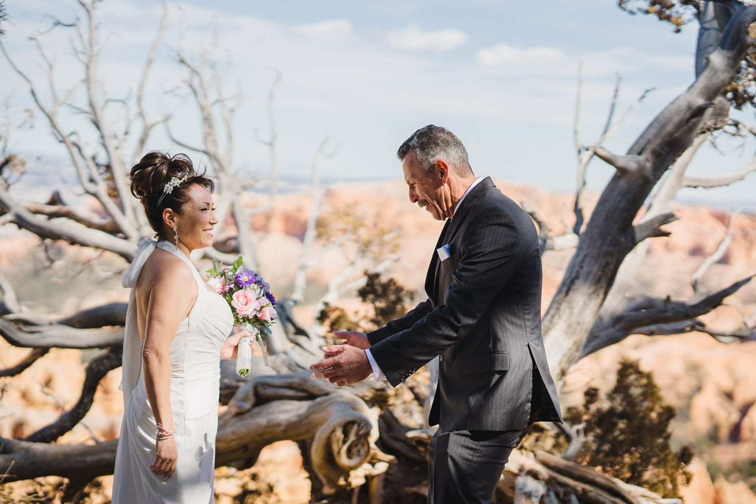 Bryce Canyon elopement smiling during first look photo