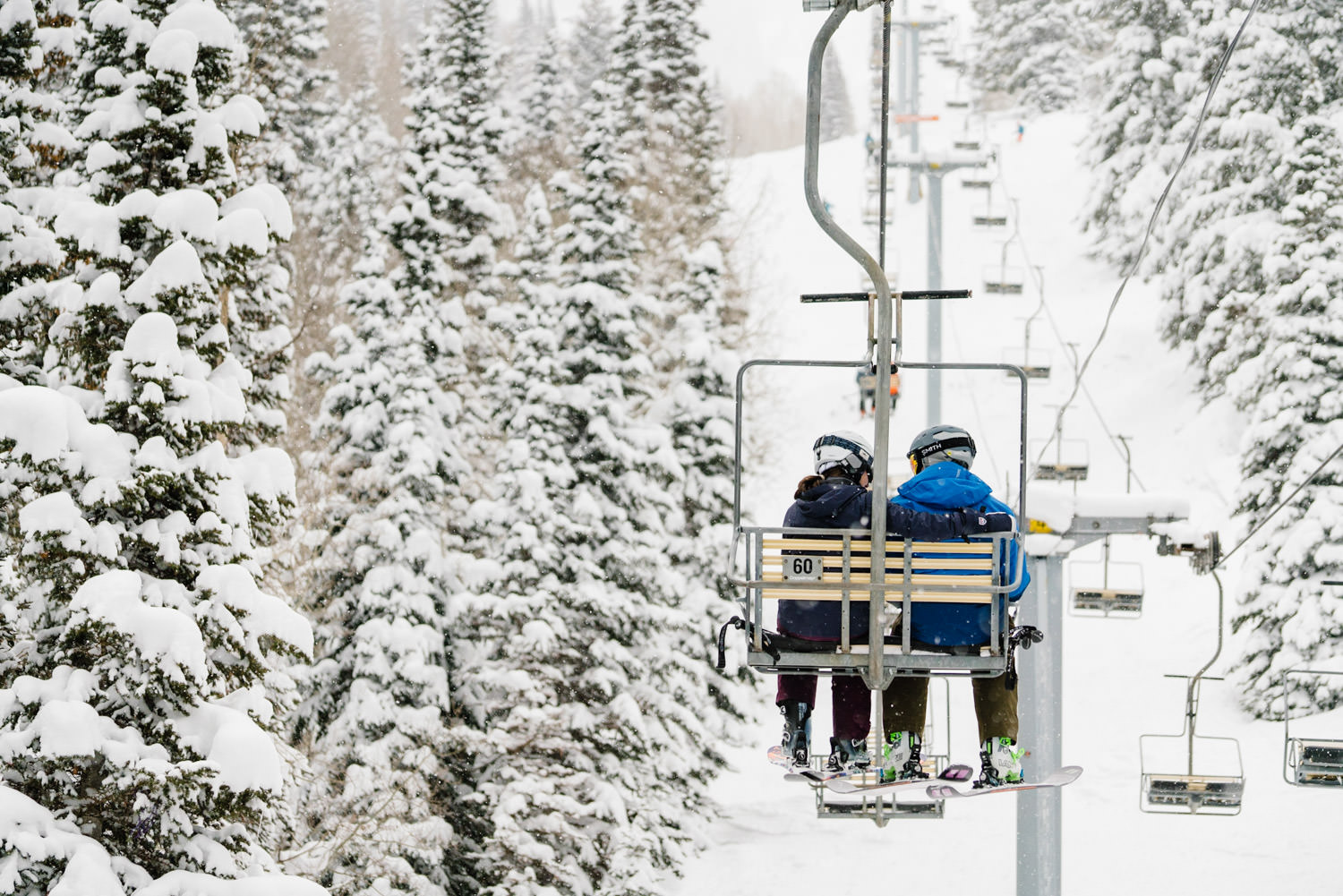 ski engagement session couple on ski lift photo