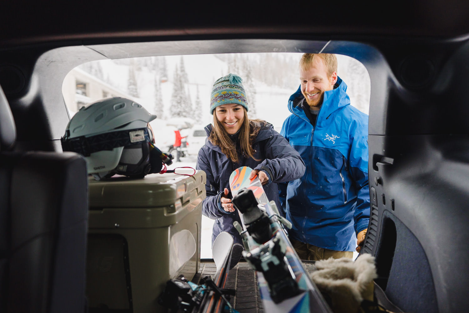 ski engagement session couple gathering gear photo
