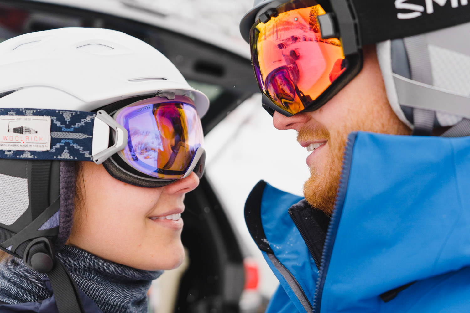 ski engagement session couple in helmets and goggles photo