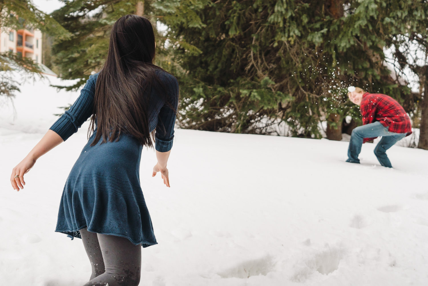Engagement session at Solitude couple having snowball fight photo