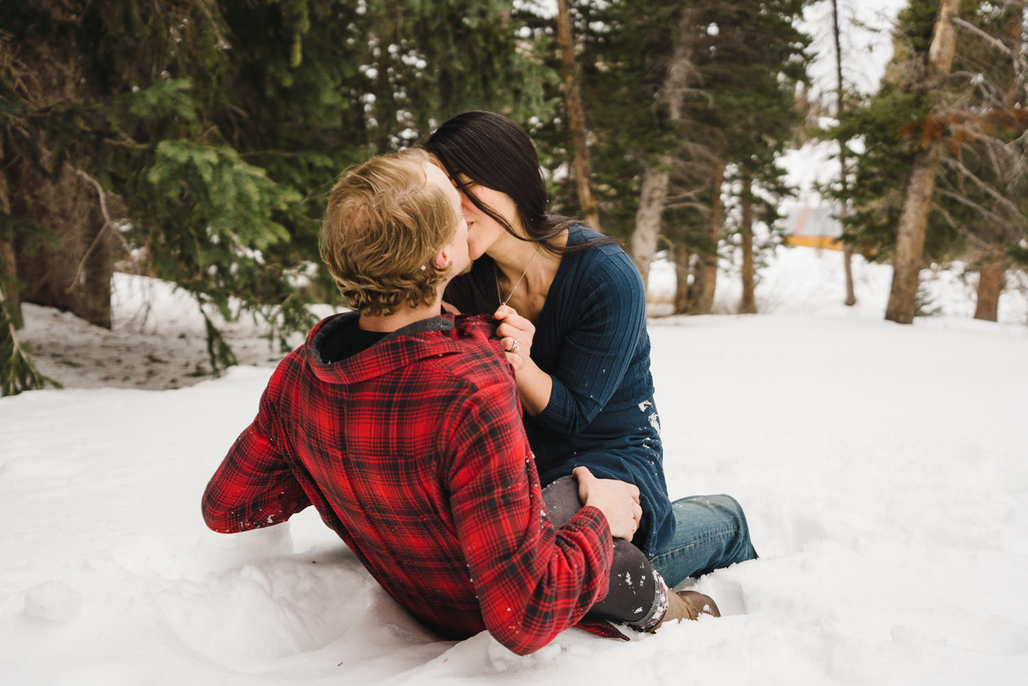 Engagement session at Solitude couple kissing in snow photo
