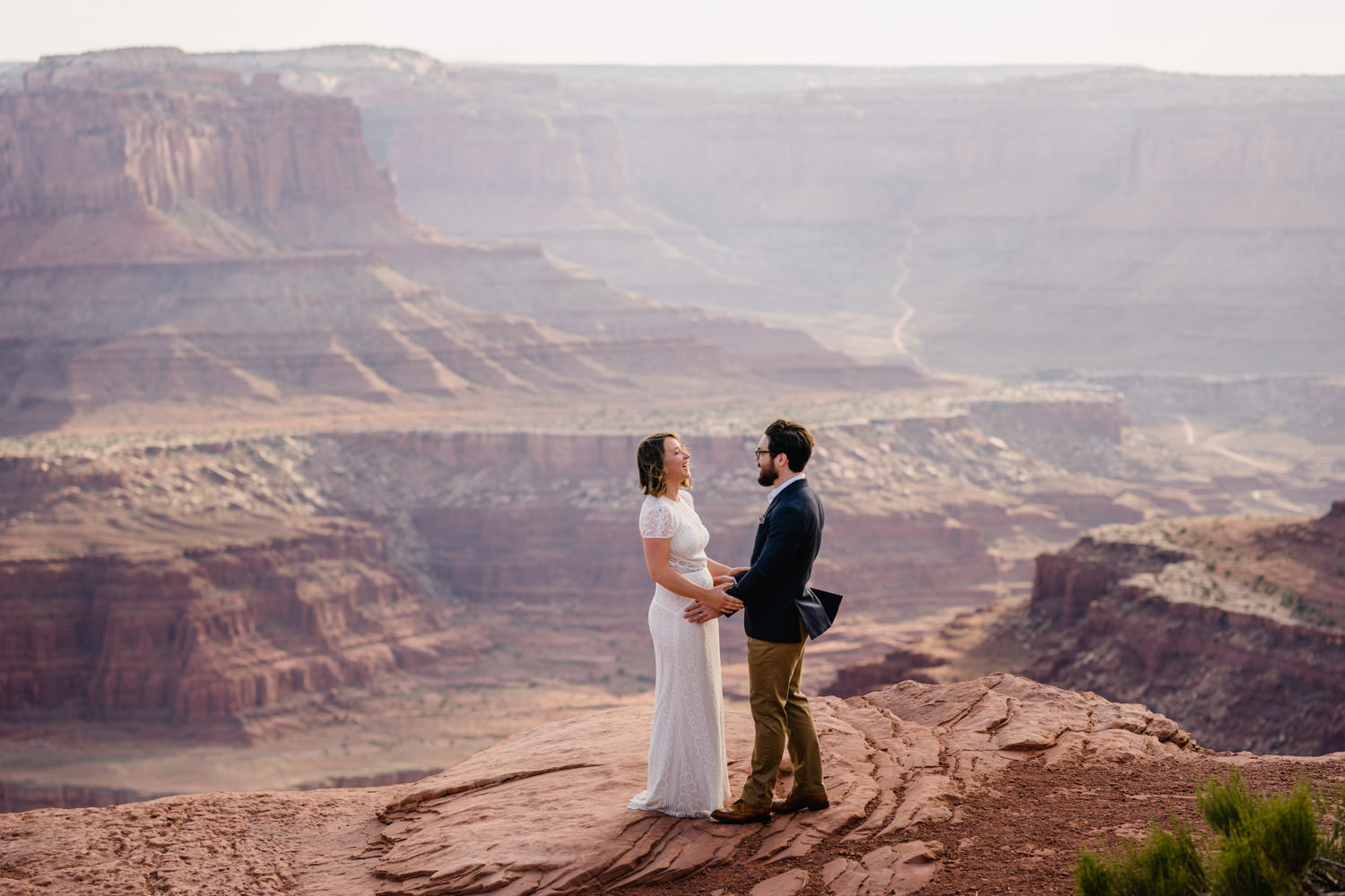 Dead Horse Point elopement bride and groom laughing photo
